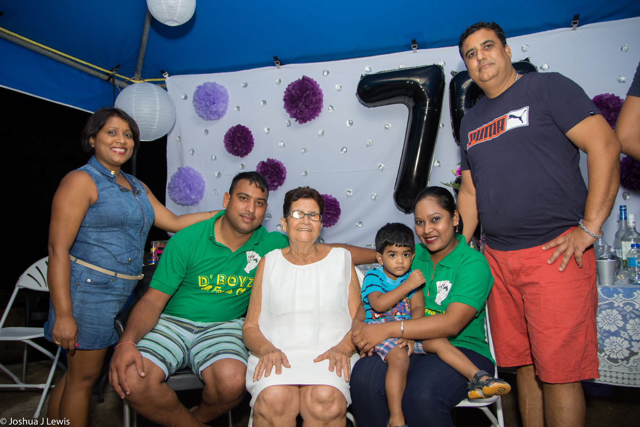 Mature Adult Sitting Happiness FamilyTime Celebration Party - Social Event Real People Love Beautiful Trinidad And Tobago Caribbean Laughing Stillife Beautiful People Birthdayparty Looking At Camera Casual Clothing Granny Togetherness