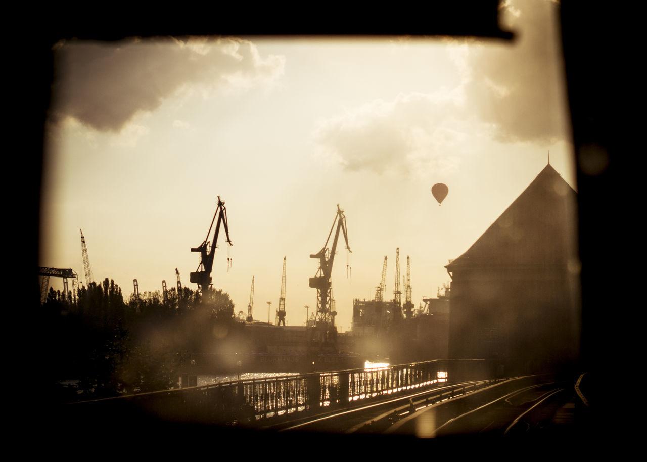 A shot through the drivers cabin. Back Light Clouds Crane Habour Hot-air Balloon Rails Subway Tube Warm