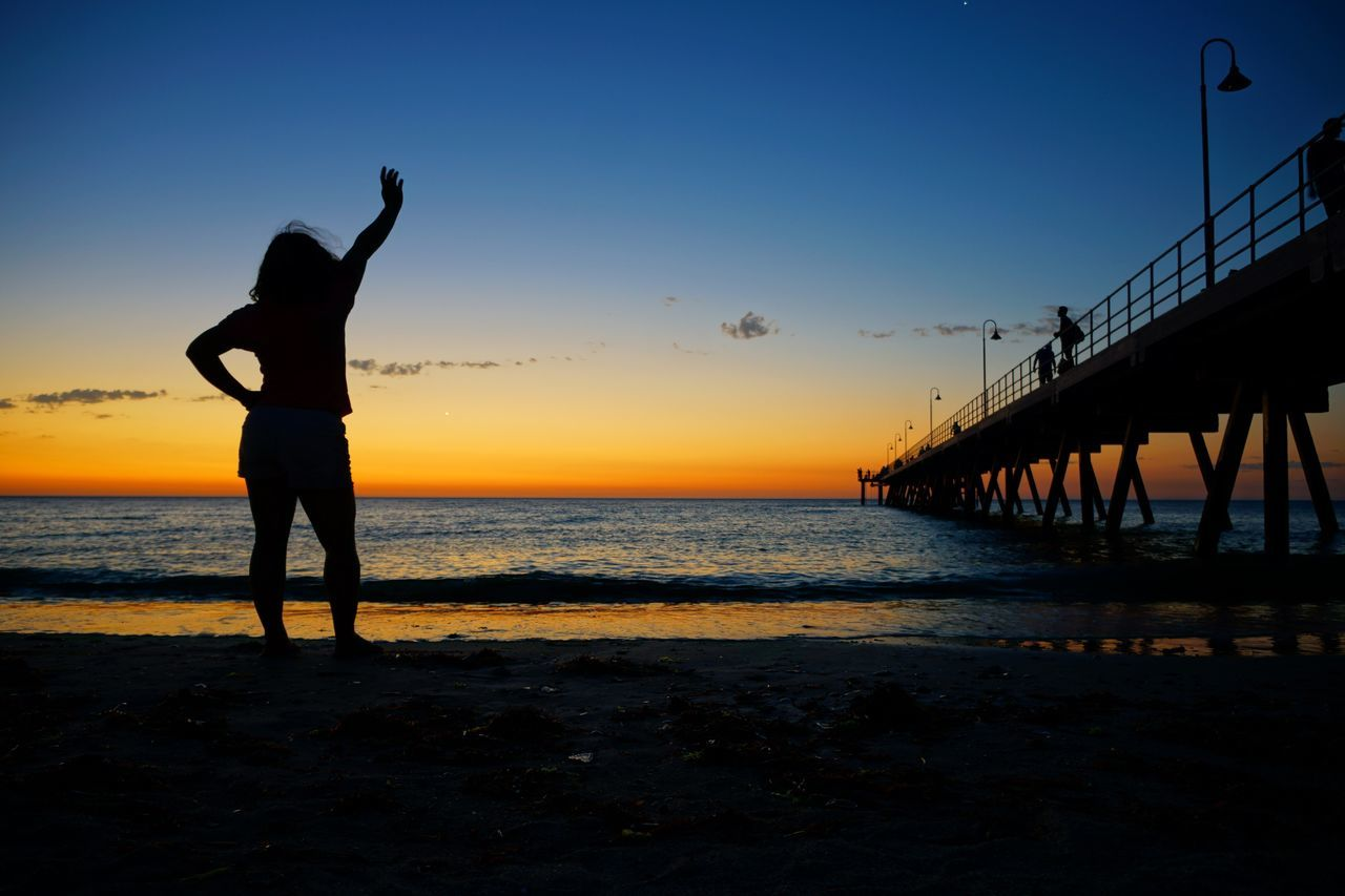 Sunset Sea Water Sky Real People Scenics Nature Beach Beauty In Nature Silhouette Horizon Over Water Idyllic Full Length Lifestyles Outdoors Leisure Activity Men Clear Sky Tranquility