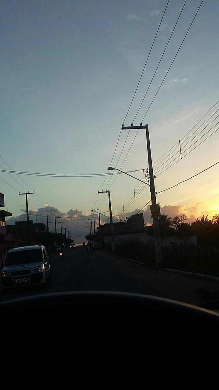 car, cable, sunset, transportation, electricity pylon, electricity, land vehicle, power line, road, sky, power supply, silhouette, connection, no people, mode of transport, cloud - sky, fuel and power generation, outdoors, nature, telephone line, technology, tree, day