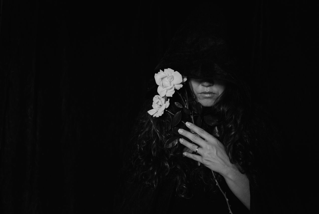 Black And White Black Background Cloaked Copy Space Dark Goodbye Grief Hand Hands Handsome Melancholy Mourning Obscured Face One Person Portrait Roses Serious Somber Studio Shot