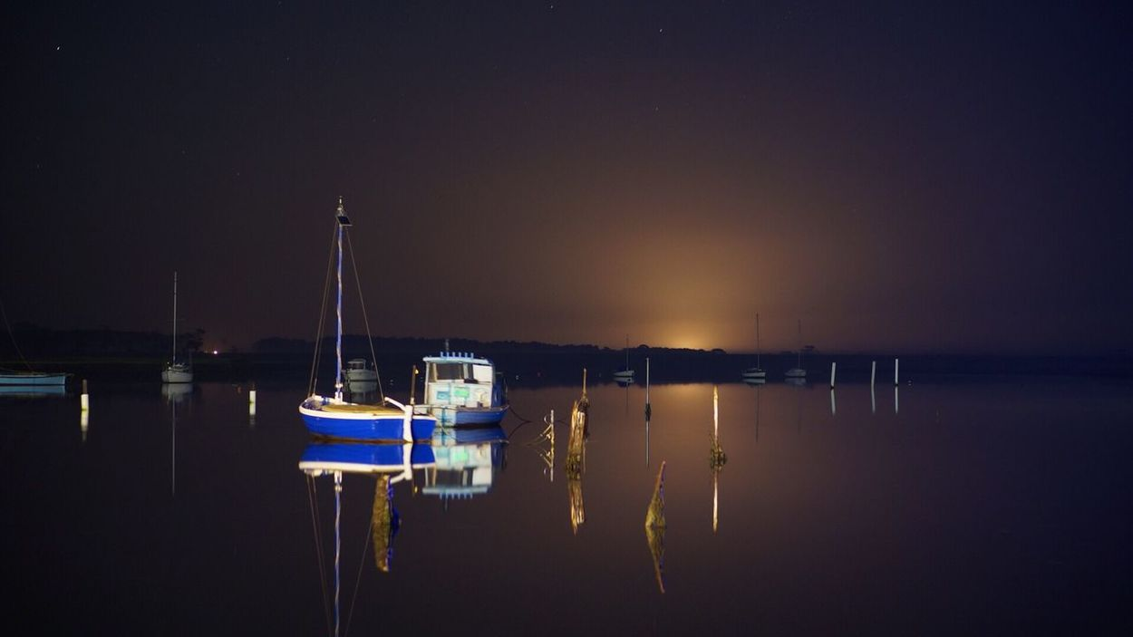 A calm and cold evening Water Reflection Nautical Vessel Waterfront Moored Boat Illuminated Night Standing Water Nature Tranquility Outdoors Sea Werribee South