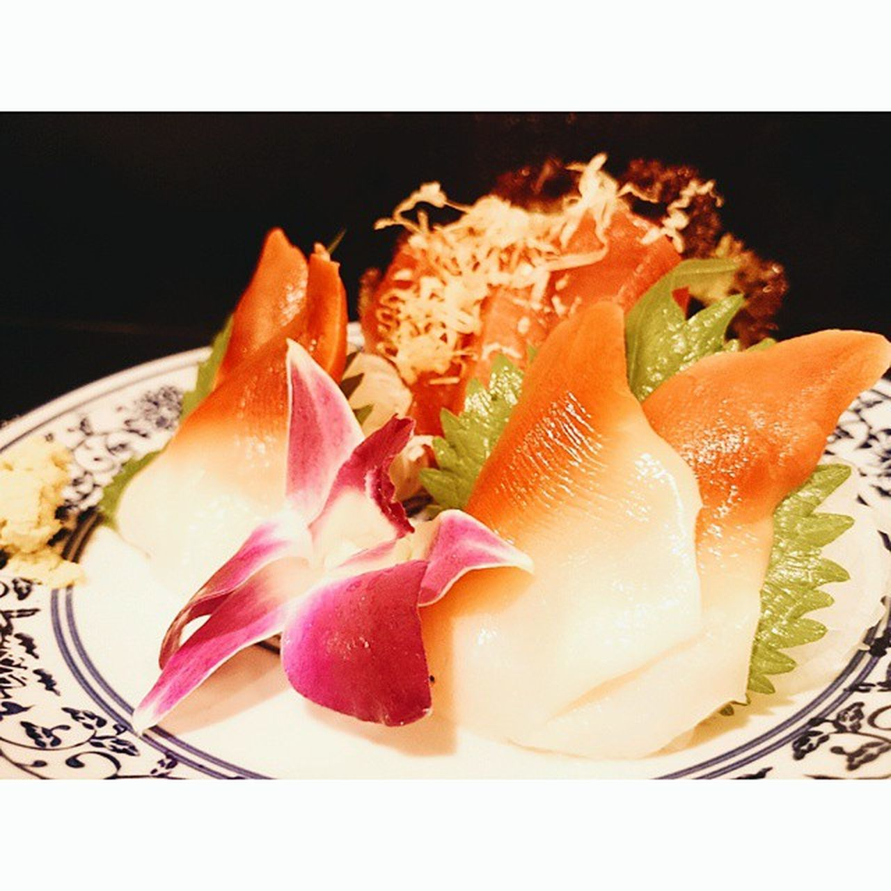 food and drink, food, plate, healthy eating, freshness, slice, indoors, no people, close-up, seafood, studio shot, sushi, black background, fruit, ready-to-eat, sashimi, day