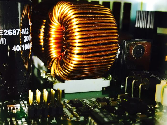 inductor coil... Coil Electronics  PCB Inductance Magnetic Coil Electromagnet Hertz Electrical Copper  Copper Coil Copper Wire Copper Wires Inductive Circuit Electronic Circuit Printed Circuit Board Electronic Circuit IPhoneography Iphoneonly Iphone7plusphoto IPhone Photography Iphonephotography IPhone7Plus