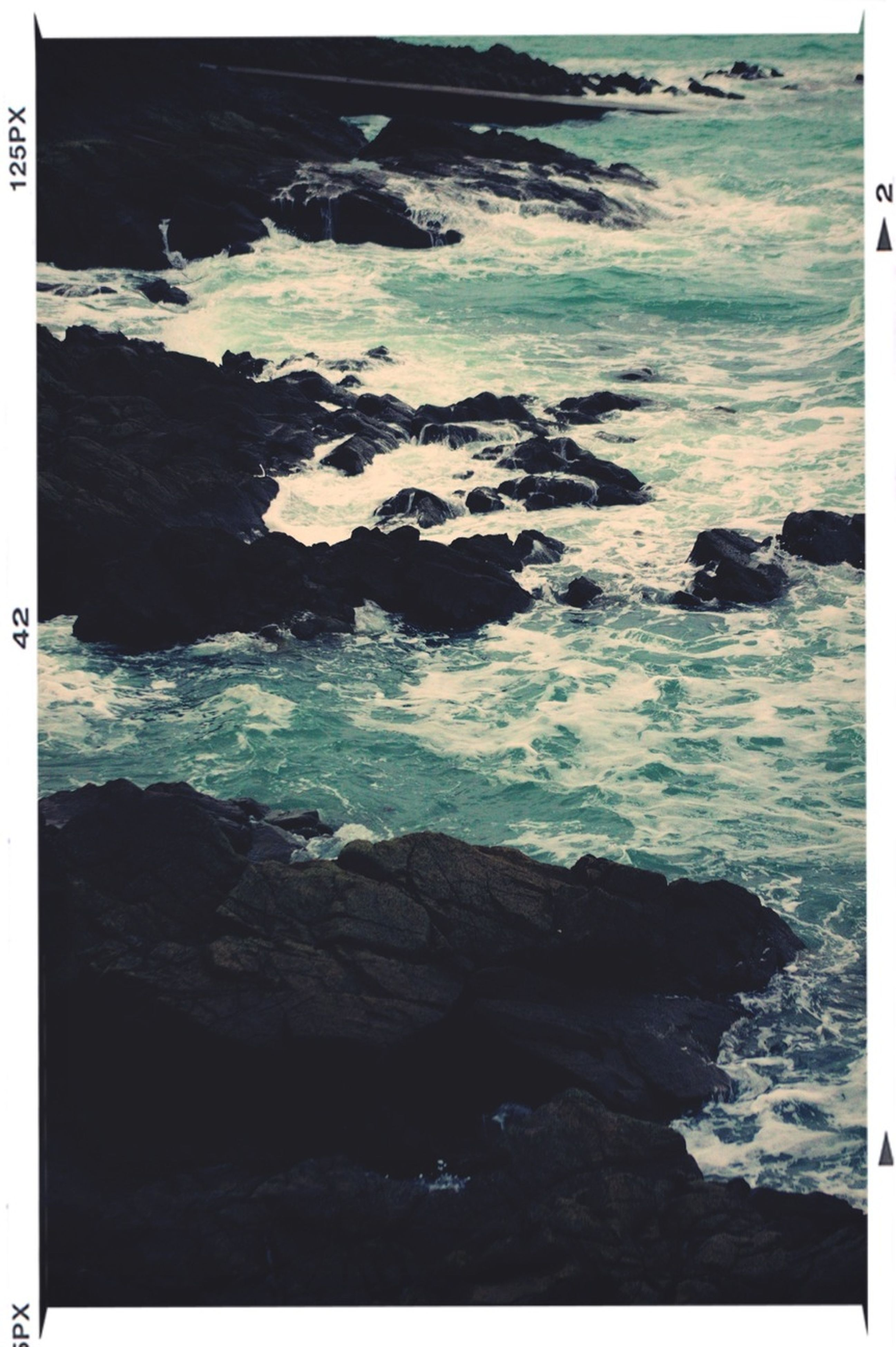 water, sea, transfer print, rock - object, auto post production filter, rock formation, scenics, beauty in nature, nature, tranquility, rock, tranquil scene, shore, beach, wave, high angle view, surf, horizon over water, coastline, idyllic