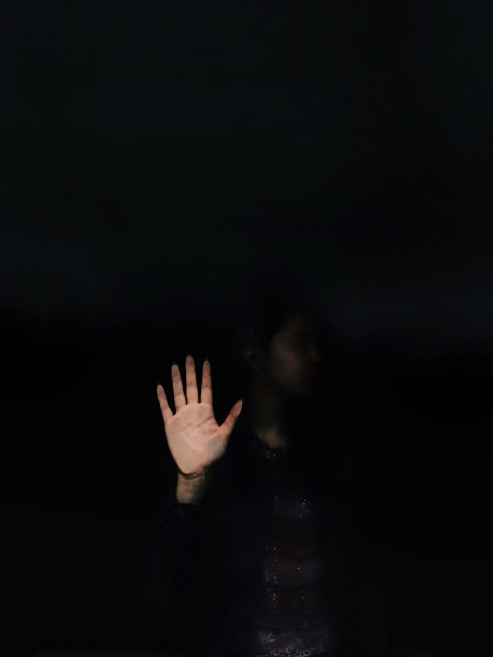 Woman Gesturing Stop While Standing Against Black Background