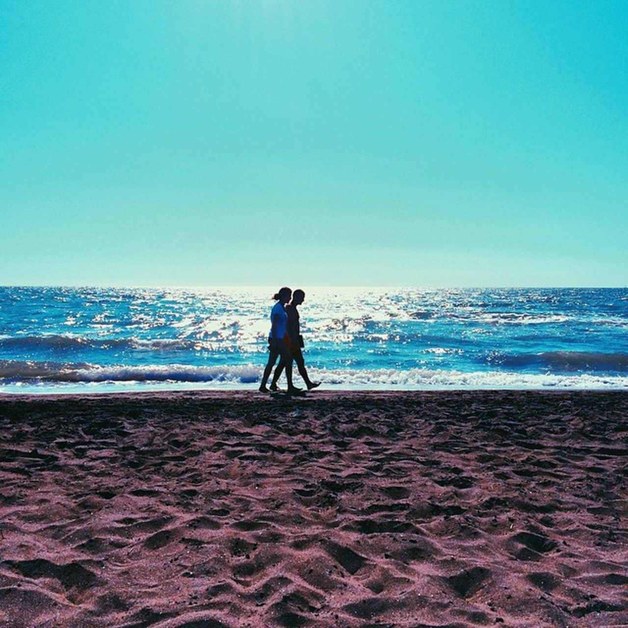 sea, beach, horizon over water, full length, nature, scenics, real people, water, beauty in nature, clear sky, walking, one person, men, sky, tranquil scene, sand, day, tranquility, outdoors, wave, people