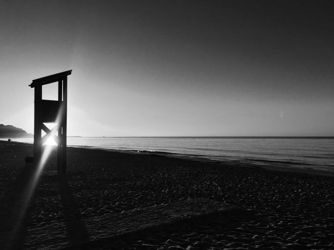Sea Horizon Over Water Beach Scenics Clear Sky Sand Idyllic No People Lifeguard Hut Blackandwhite Tranquility Tranquil Scene Sun Sunrise Lens Flare Enjoying The Sun Enjoying The Moment Silhouette Silence Calm