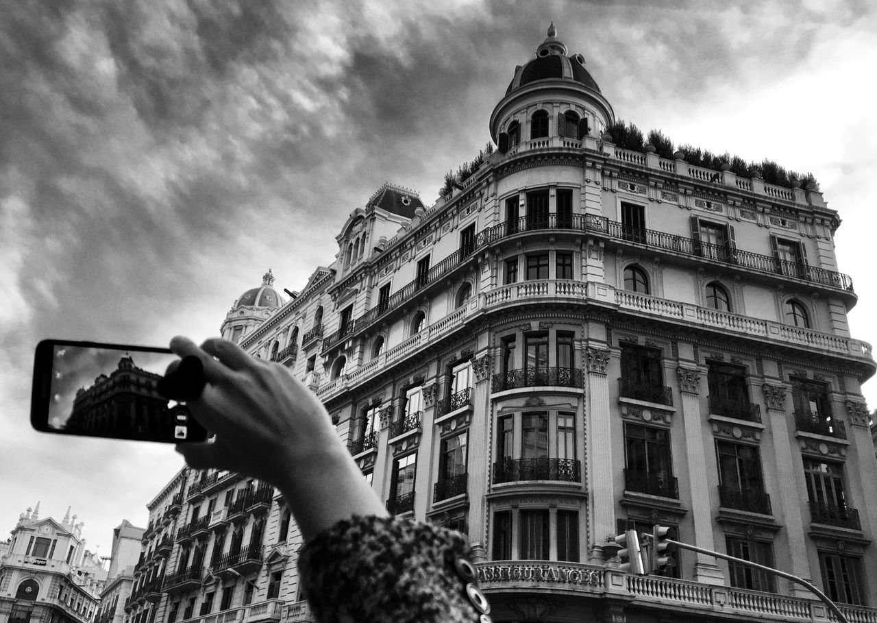 Building Exterior Architecture Built Structure Low Angle View Sky Outdoors Real People City Cloud - Sky Day One Person Human Hand Barcelona Blackandwhite Photography Blackandwhite Bnw_captures Bnw_collection Architecture Streetphoto_bw EyeEm Gallery Eye4photography  EyeEm Best Shots