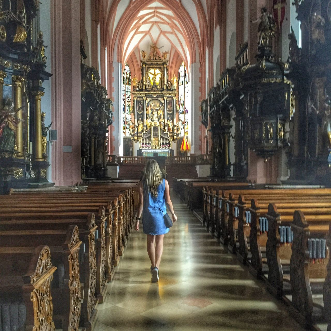 religion, spirituality, full length, place of worship, indoors, rear view, arch, pew, tourism, one person, architecture, architectural column, real people, day, women, people, adult, adults only