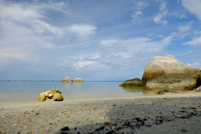 Trikora Beach Beach Beauty In Nature Calm Nature Pebble Rock - Object Sand Scenics Sea Selective Focus Shore Sky Stone Stone - Object Surface Level Tourism Tranquil Scene Tranquility Travel Destinations Water