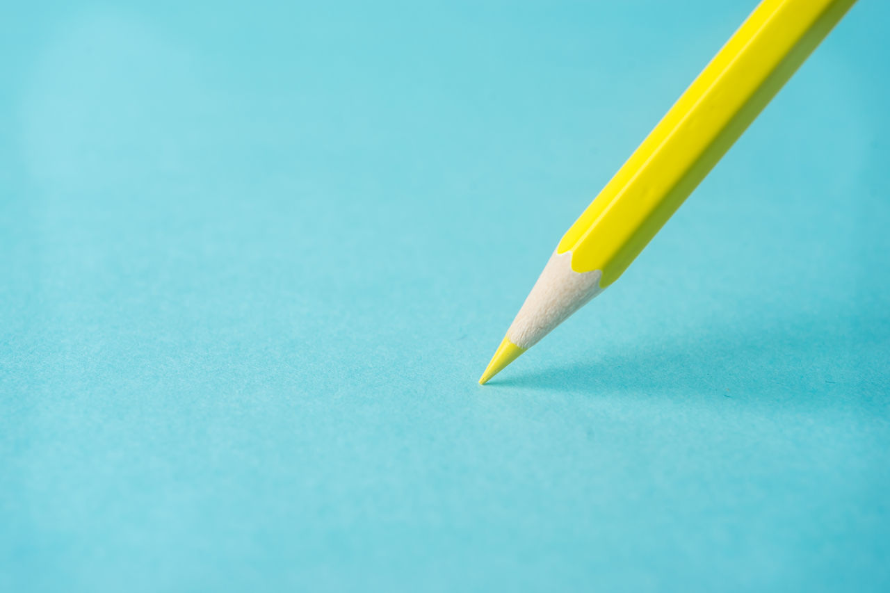 pencil, still life, close-up, studio shot, yellow, no people, paper, blue, indoors, day