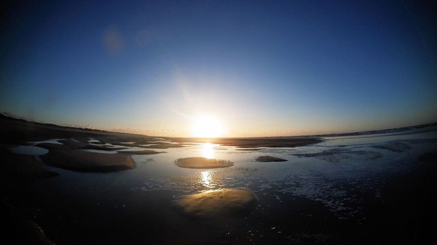 Ultrawide angle action cam shot of sunset by the beach North Sea coast Germany Sunset_collection Beach Beauty In Nature Clear Sky Day Germany Landscape Nature No People Norderney Norderney Ist Mein Hawaii Nordsee Outdoors Scenics Sea Sky Sun Sunlight Sunset Tranquil Scene Tranquility Water Winter