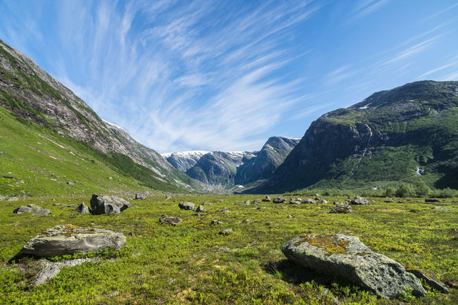 On the way to Austerdalsbreen Beauty In Nature Blue Cirrostratus Grassy Green Color Hiking Idyllic Landscape Mountain Mountain Range Nature Non Urban Scene Non-urban Scene Outdoors Remote Rock Rock - Object Rocky Scenics Sky Summer Sunny Valley Wanderlust