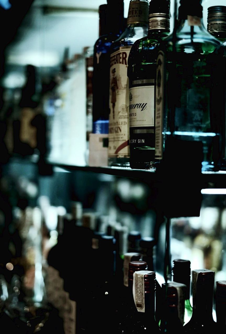 Gin Bottles Arranged On Shelf In Restaurant
