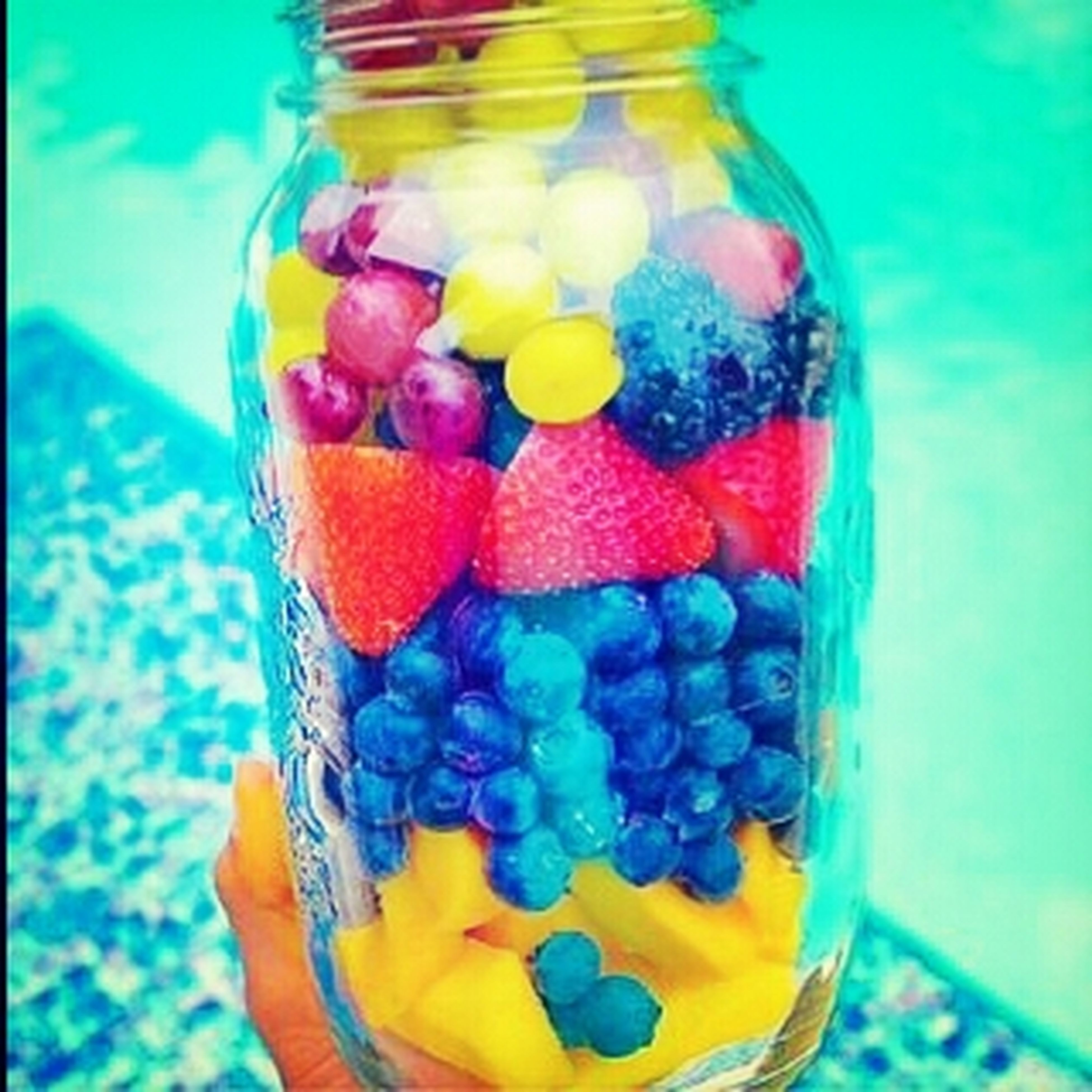 indoors, multi colored, food and drink, still life, sweet food, close-up, freshness, food, colorful, glass - material, dessert, blue, candy, fruit, unhealthy eating, indulgence, table, variation, yellow, transparent