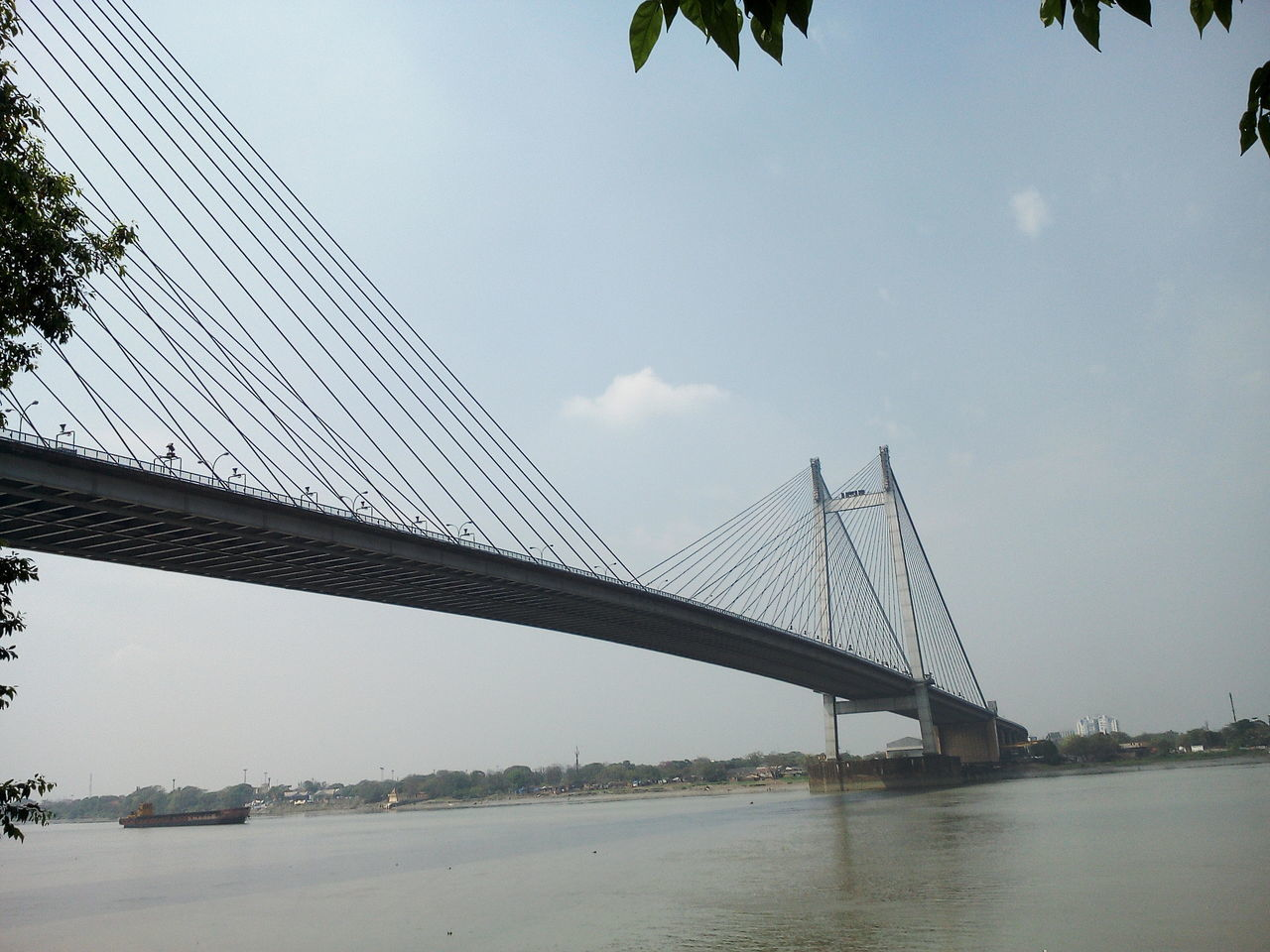 bridge - man made structure, connection, engineering, suspension bridge, built structure, architecture, sky, transportation, bridge, river, outdoors, day, water, travel, travel destinations, no people, tree, city, nature