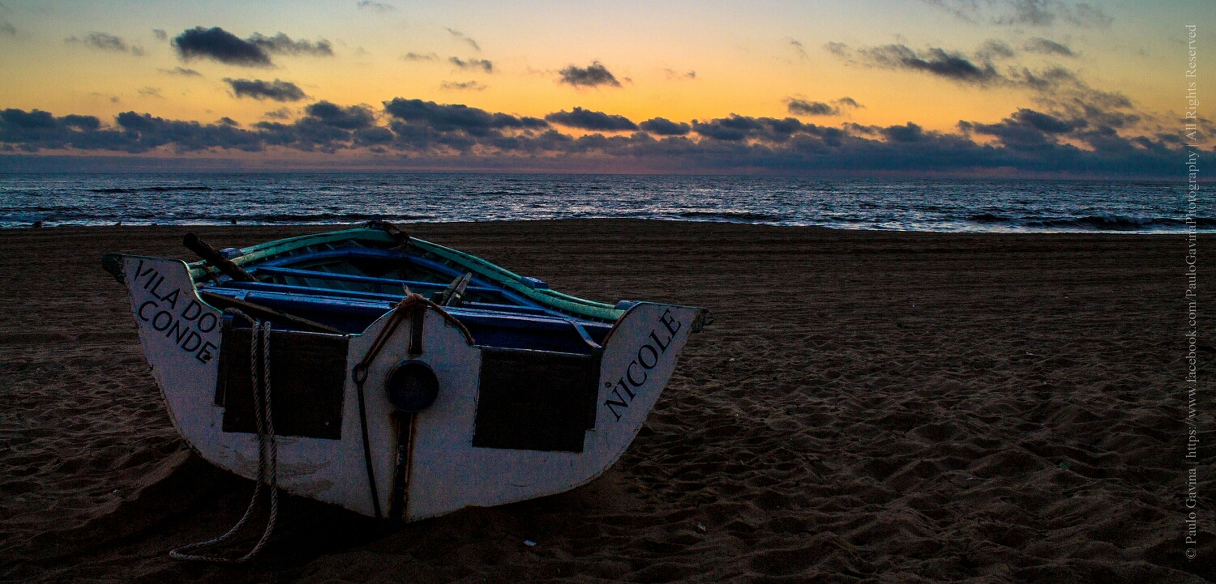 sea, horizon over water, sunset, water, beach, sky, tranquility, scenics, tranquil scene, shore, beauty in nature, orange color, nature, idyllic, sand, cloud - sky, nautical vessel, transportation, boat, cloud