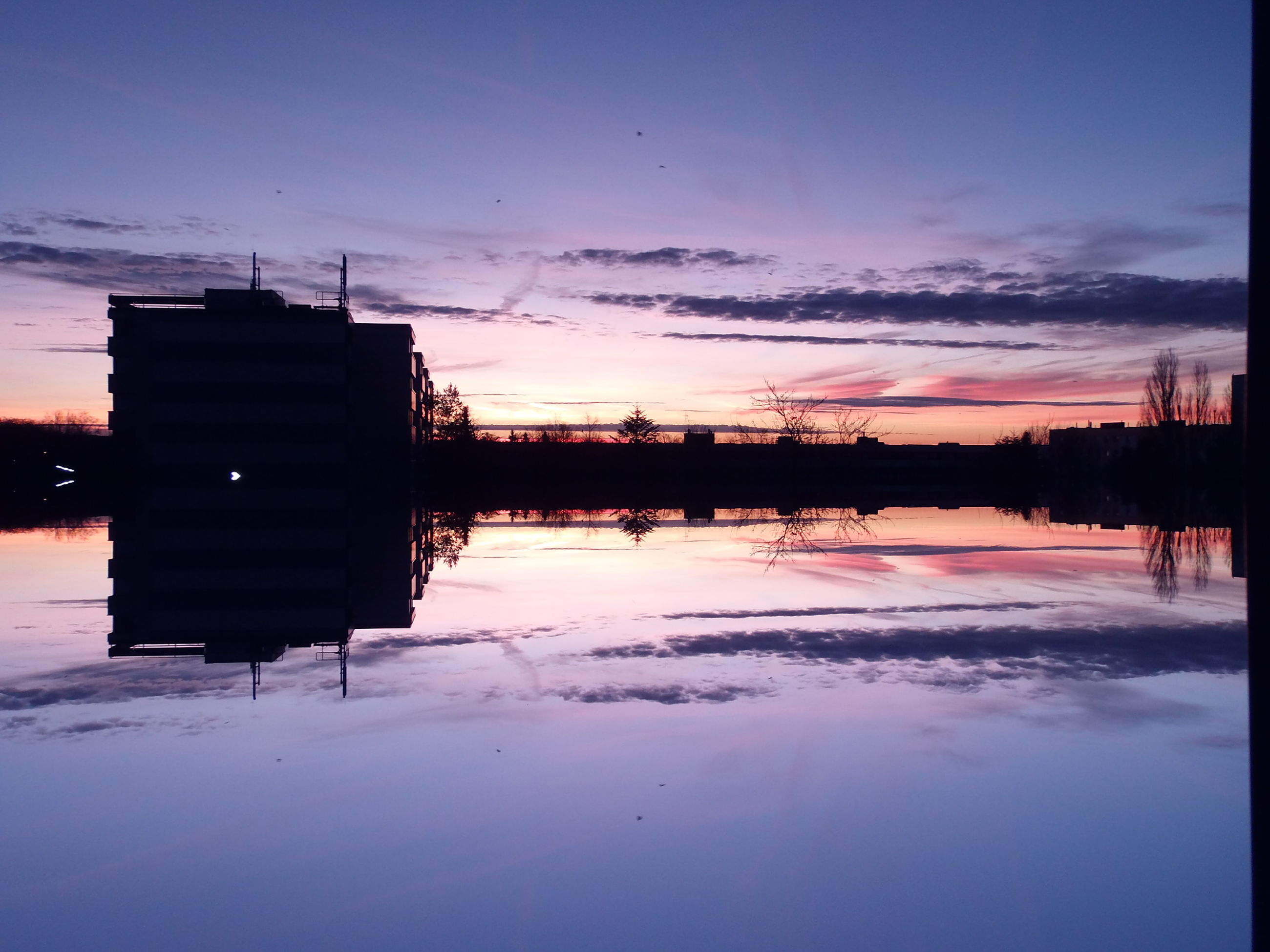 sunset, winter, cold temperature, snow, sky, reflection, water, silhouette, built structure, season, weather, dusk, building exterior, tranquility, tranquil scene, scenics, architecture, cloud - sky, beauty in nature, lake