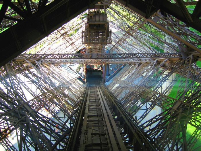 Inside the Eiffel Tower Architectural Feature Architecture Built Structure Diminishing Perspective Eiffel Tower Engineering France Low Angle View Metallic Steelwork Tall Tall - High Tourism Travel Travel Destinations