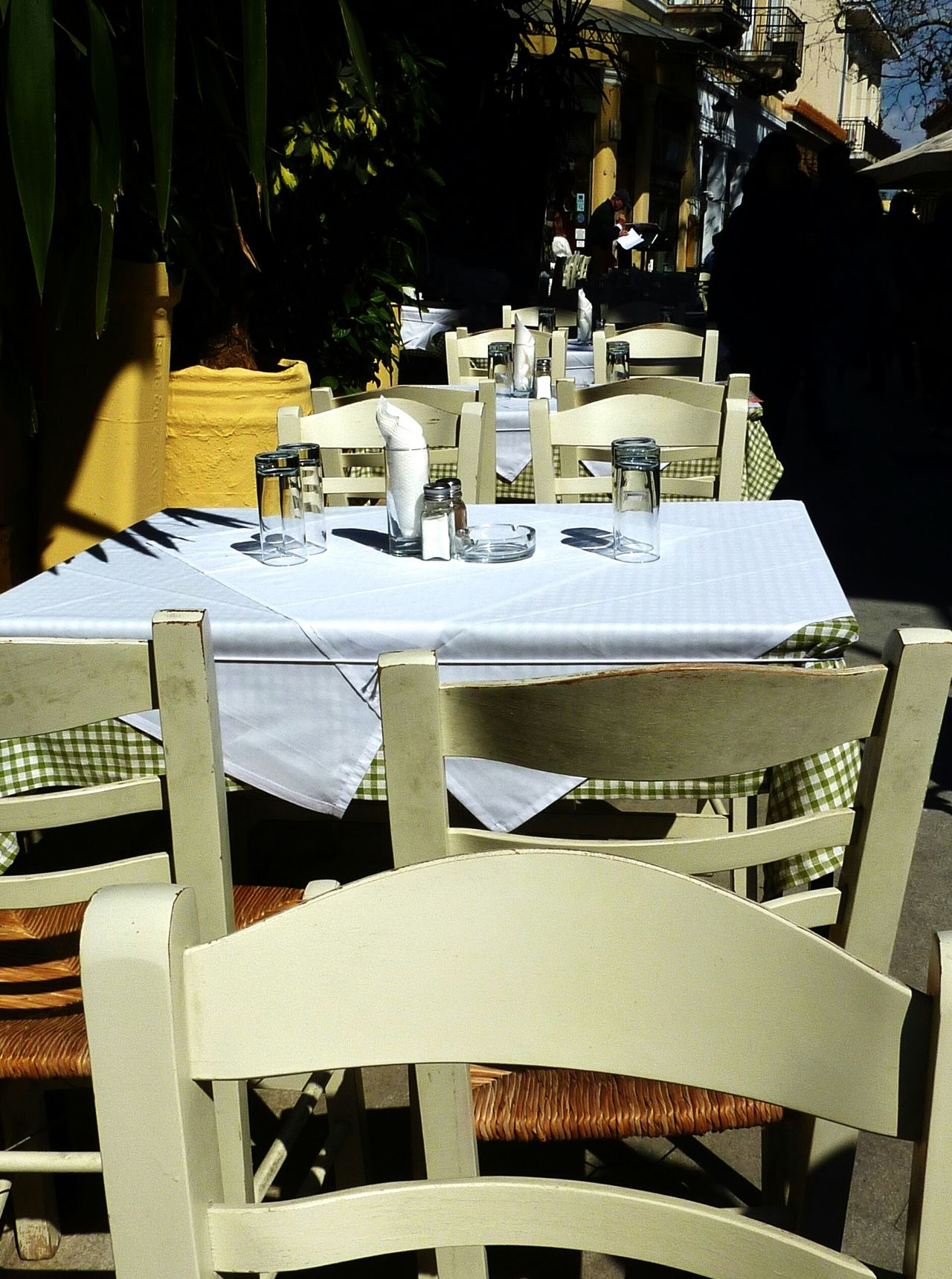 You are welcome EyeEm Gallery Street Photography Restaurant Greece Mediteranean Restaurant Scene Restaurants Plates On A Table White Meal Mealtime Dishes Tourists Sunny Day Outdoor Cafe Outdoor Restaurant Ambiente