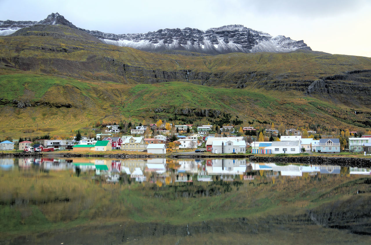 Architecture Beauty In Nature Built Structure Countryside Day Grass Green Color Hill House Iceland Iceland_collection Idyllic Landscape Mountain Mountain Range Nature Non-urban Scene Residential Structure Seyðisfjörður Sky Town Tranquil Scene Tranquility Travel Village