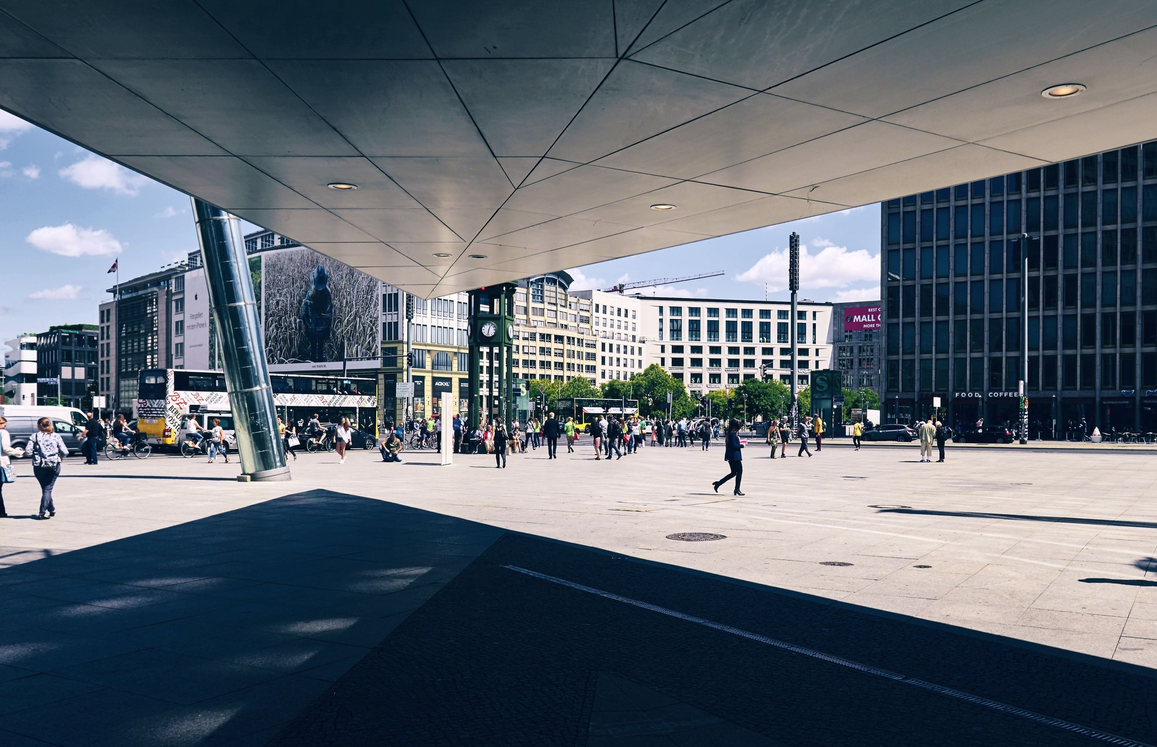 People On Footpath Against Buildings In City
