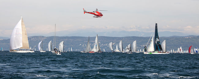 The Barcolana is a historic international sailing regatta taking place every year in the Gulf of Trieste on the second Sunday of October. The Barcolana is one of the most crowded regattas in the world, which draw ... Bora Elicopter Eye4photography  Journey Nature Outdoors Popular Regatta Sail Sailboat Sailing Ship Sea Seascape Sky Sport Storytelling Taking Pictures Water Waterfront Waves Wing World
