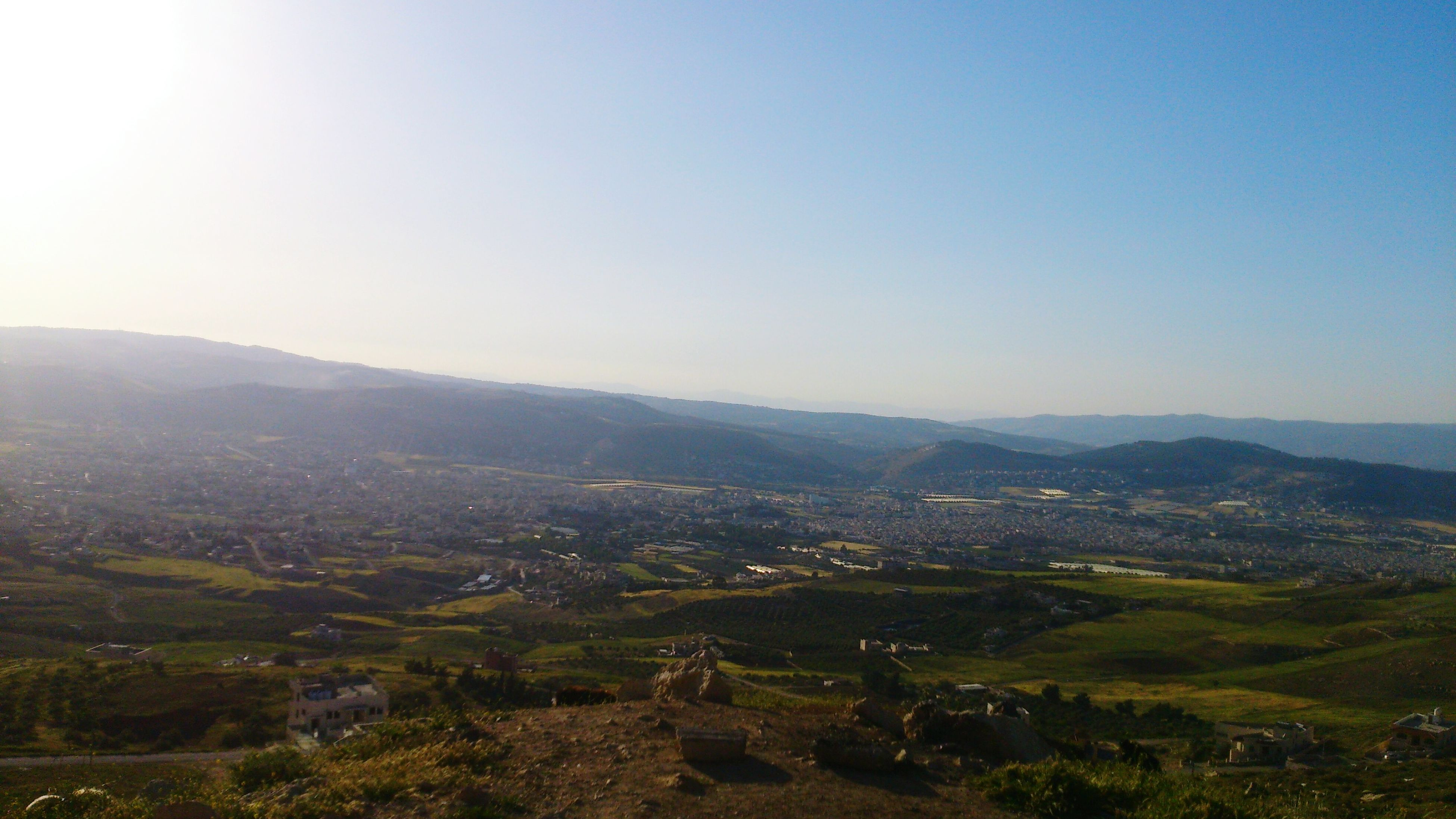 landscape, clear sky, mountain, tranquil scene, tranquility, scenics, copy space, beauty in nature, tree, nature, high angle view, mountain range, hill, non-urban scene, idyllic, green color, horizon over land, outdoors, field