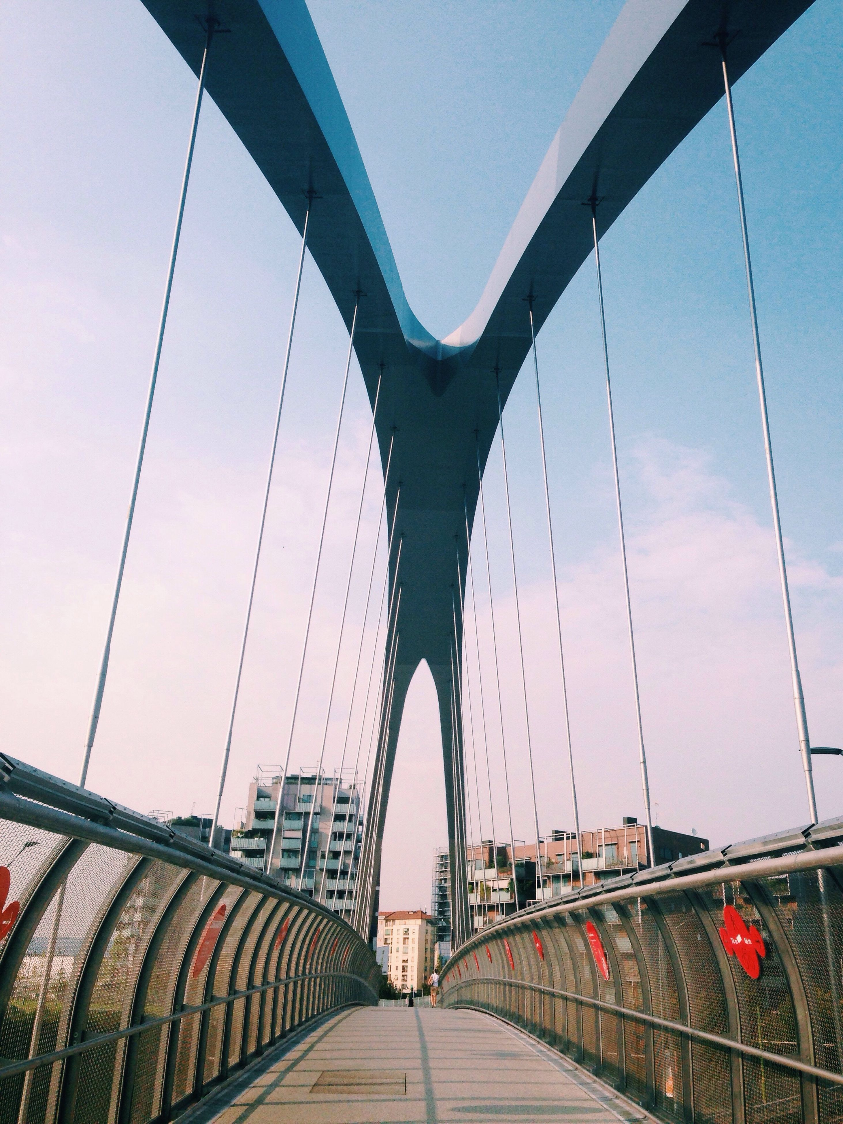 architecture, built structure, transportation, bridge - man made structure, engineering, connection, suspension bridge, bridge, the way forward, clear sky, cable-stayed bridge, steel cable, sky, day, railing, water, river, outdoors, arch, long, city life, supported