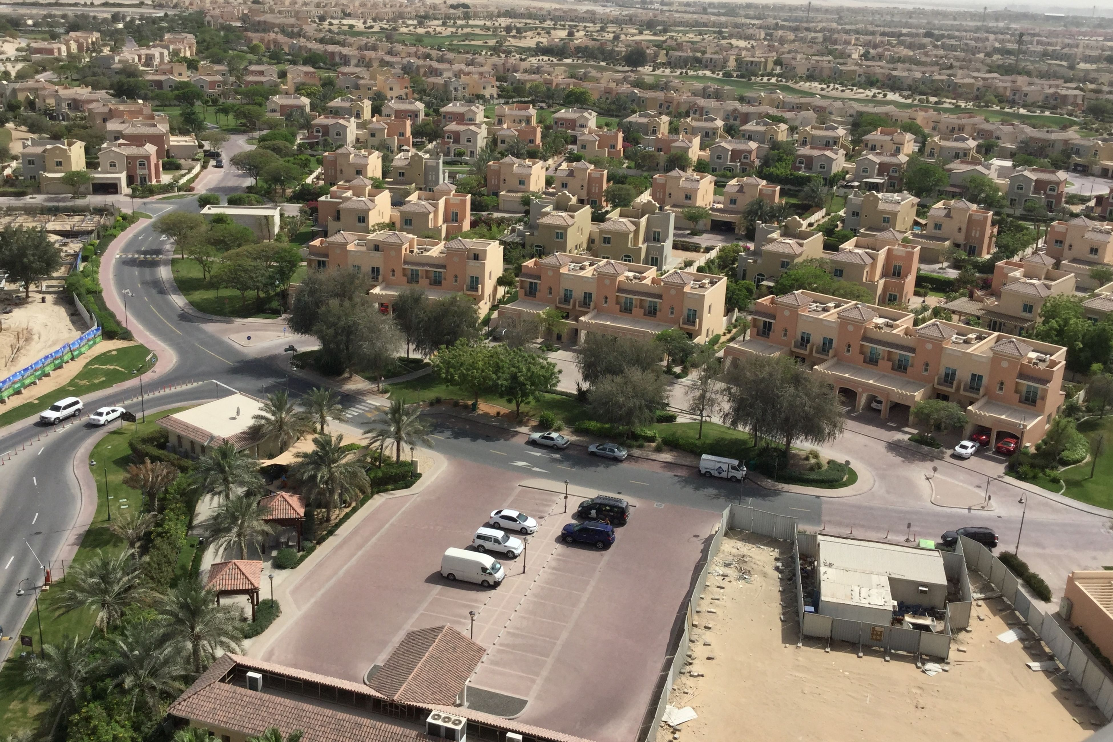 high angle view, building exterior, architecture, built structure, city, road, transportation, cityscape, car, aerial view, crowded, tree, residential district, street, land vehicle, residential building, elevated view, residential structure, city life, mode of transport