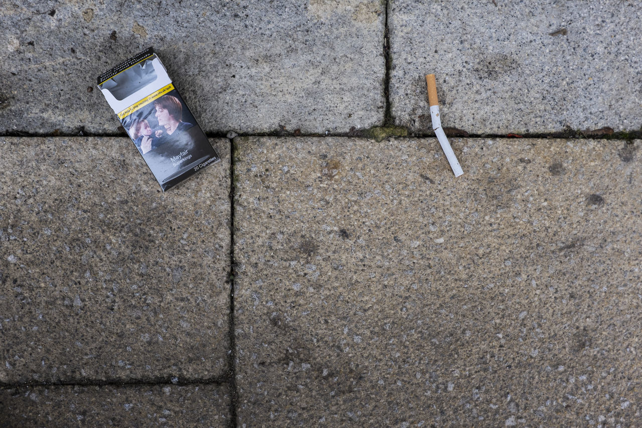 A broken cigarette, the last of the pack, lay broken adjacent to the empty packet. Found as pictured on a street in the UK Broken Cigarette  Cigarettes Discarded Dropped Empty Filter Garbage Health Health Risk Health Warning Nicotine Outdoor Outdoors Outdoors Photograpghy  Outdoors Photography Outside Outside Photography Pavement Stop Smoking Street Street Photo Street Photography Thrown Away Tobacco