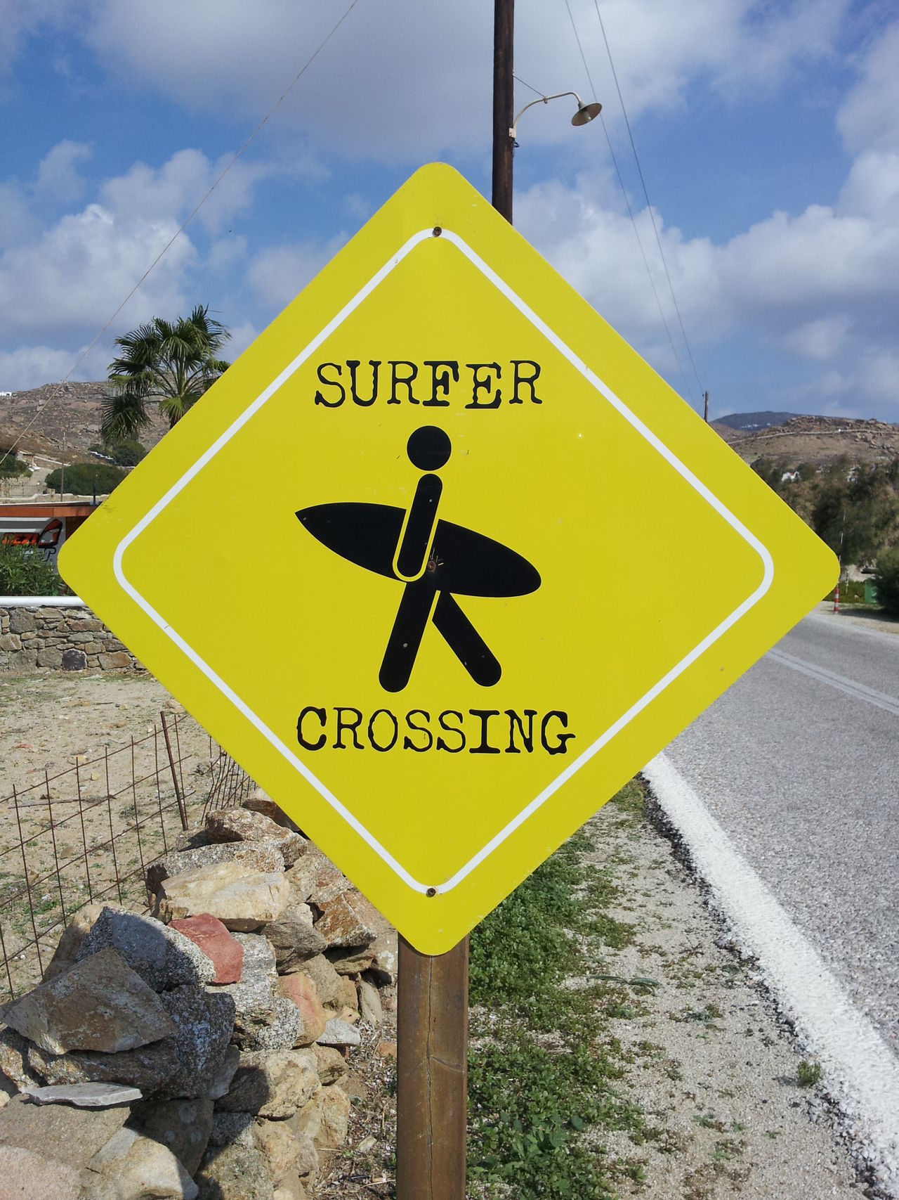 Attention Cloud - Sky Communication Crossing The Street Day Guidance No People Outdoors Road Sign Sign Sky Surfer Text Yellow