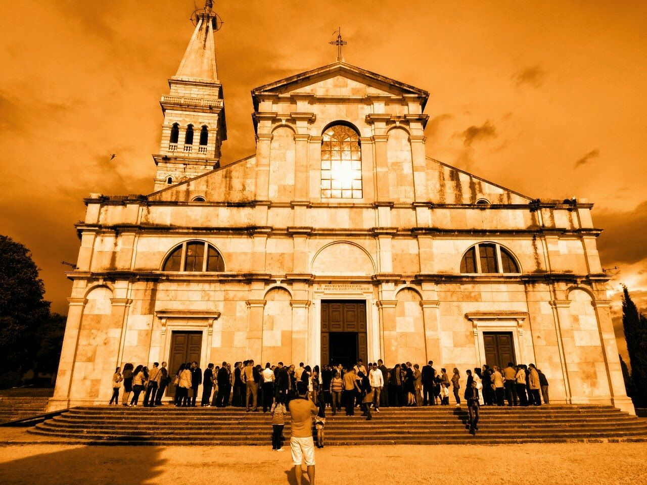 architecture, large group of people, religion, built structure, building exterior, place of worship, spirituality, men, people, outdoors, day, adult, sky, adults only
