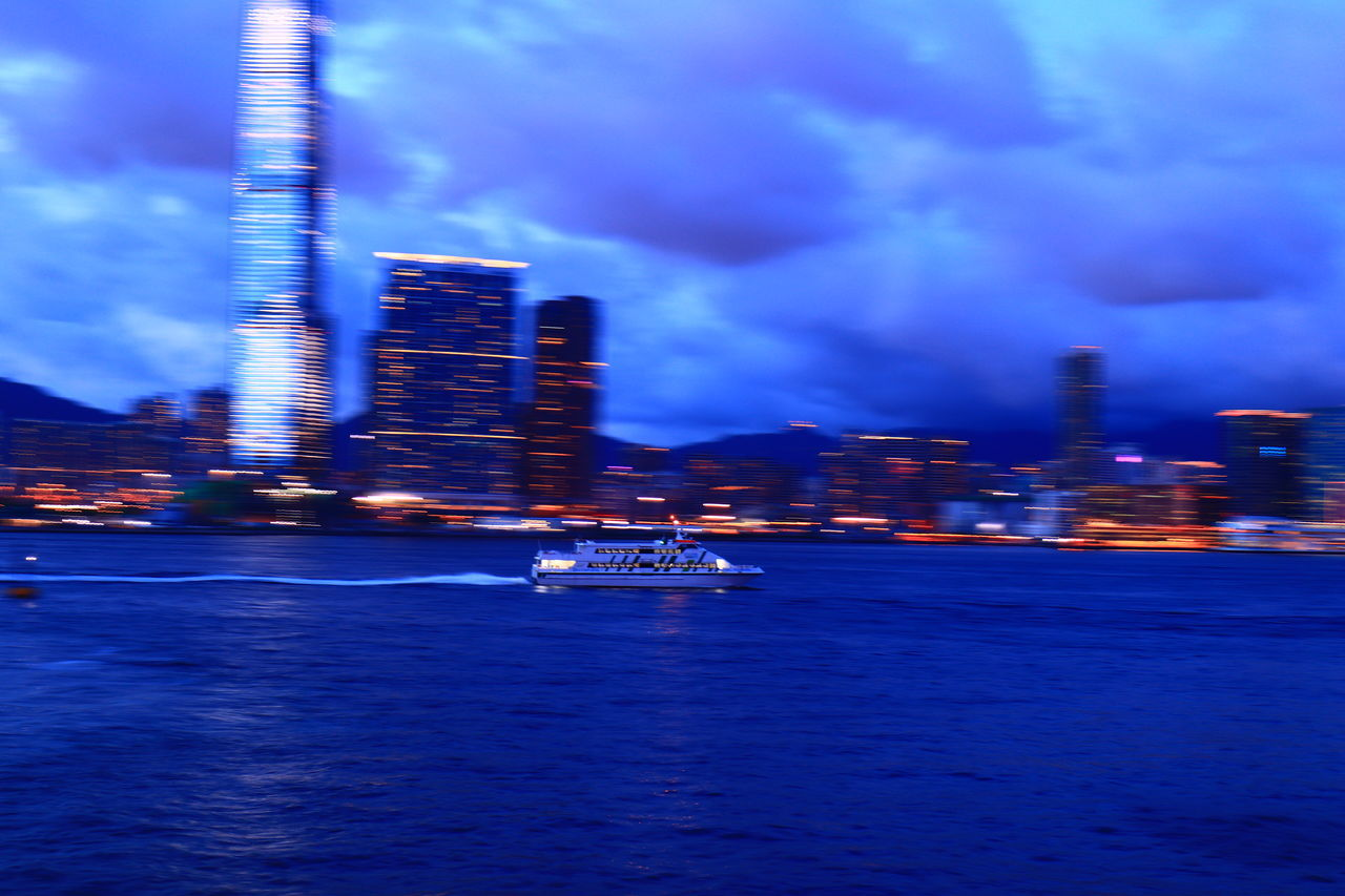 transportation, nautical vessel, illuminated, architecture, mode of transport, built structure, building exterior, sky, night, waterfront, skyscraper, outdoors, city, no people, water, sea, travel destinations, nature, cityscape, urban skyline, motion, blue, sailing