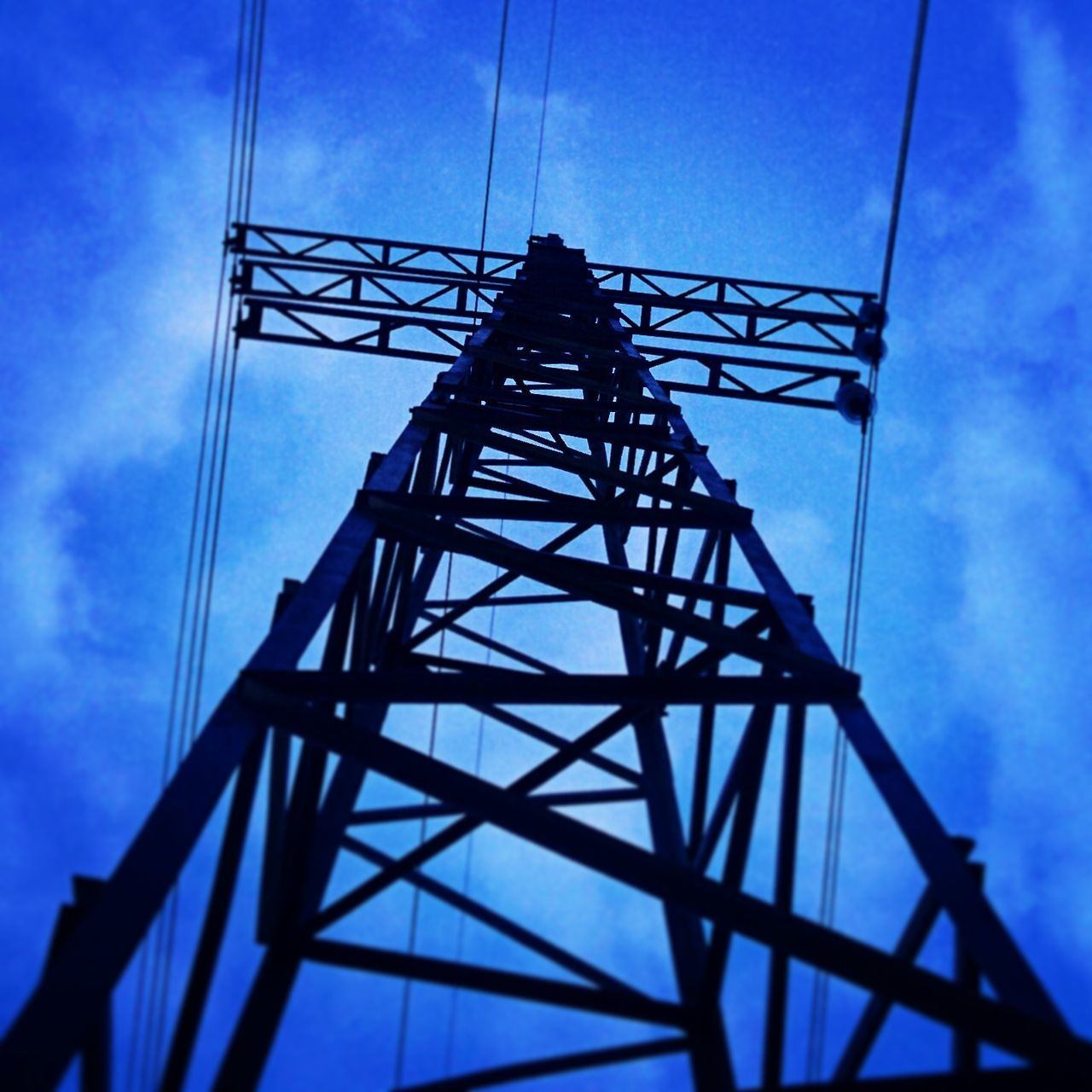 tower, cable, low angle view, silhouette, electricity pylon, sky, cloud - sky, day, architecture, built structure, outdoors, no people, water tower - storage tank