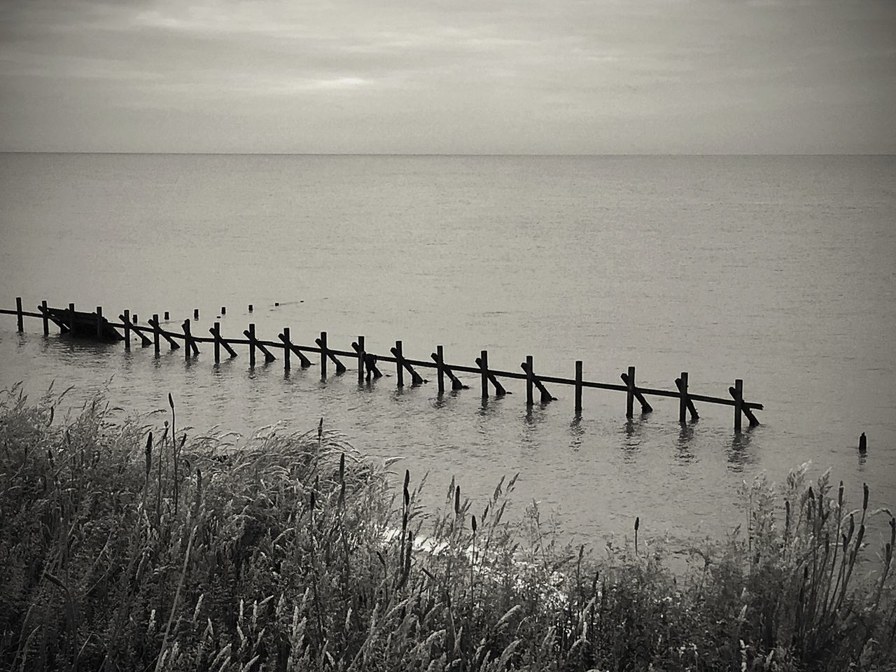 Beauty In Nature Horizon Over Water Seascape Standing Water Erosion Control Happisburgh Erosion Effects Shore Line Shoreline Coastal Defence Work Coastal Defences Coastal_collection Coastline Coastal Erosion Coastal Feature Beach Defence Erosion Beach Erosion Sea Defences Sea Defence EyeEm Best Shots - Black + White EyeEmBestPics Wooden Posts EyeEm Gallery EyeEm Best Shots - Landscape