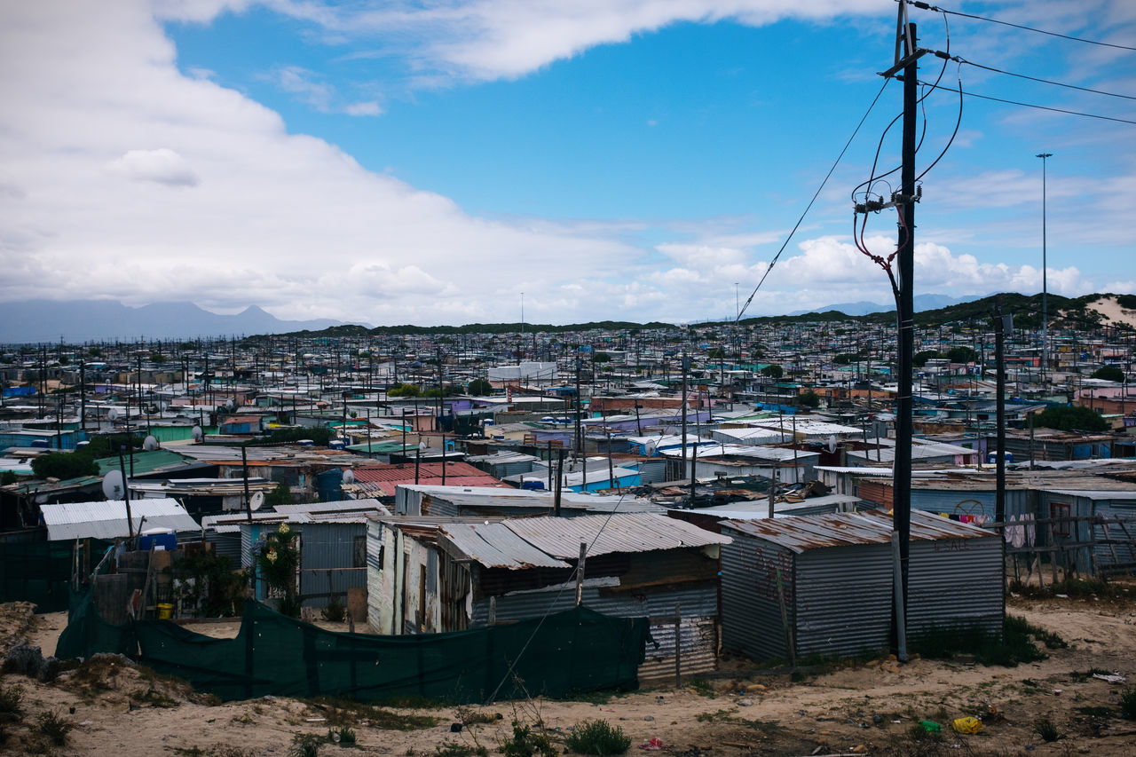 Slums Against Sky In Town
