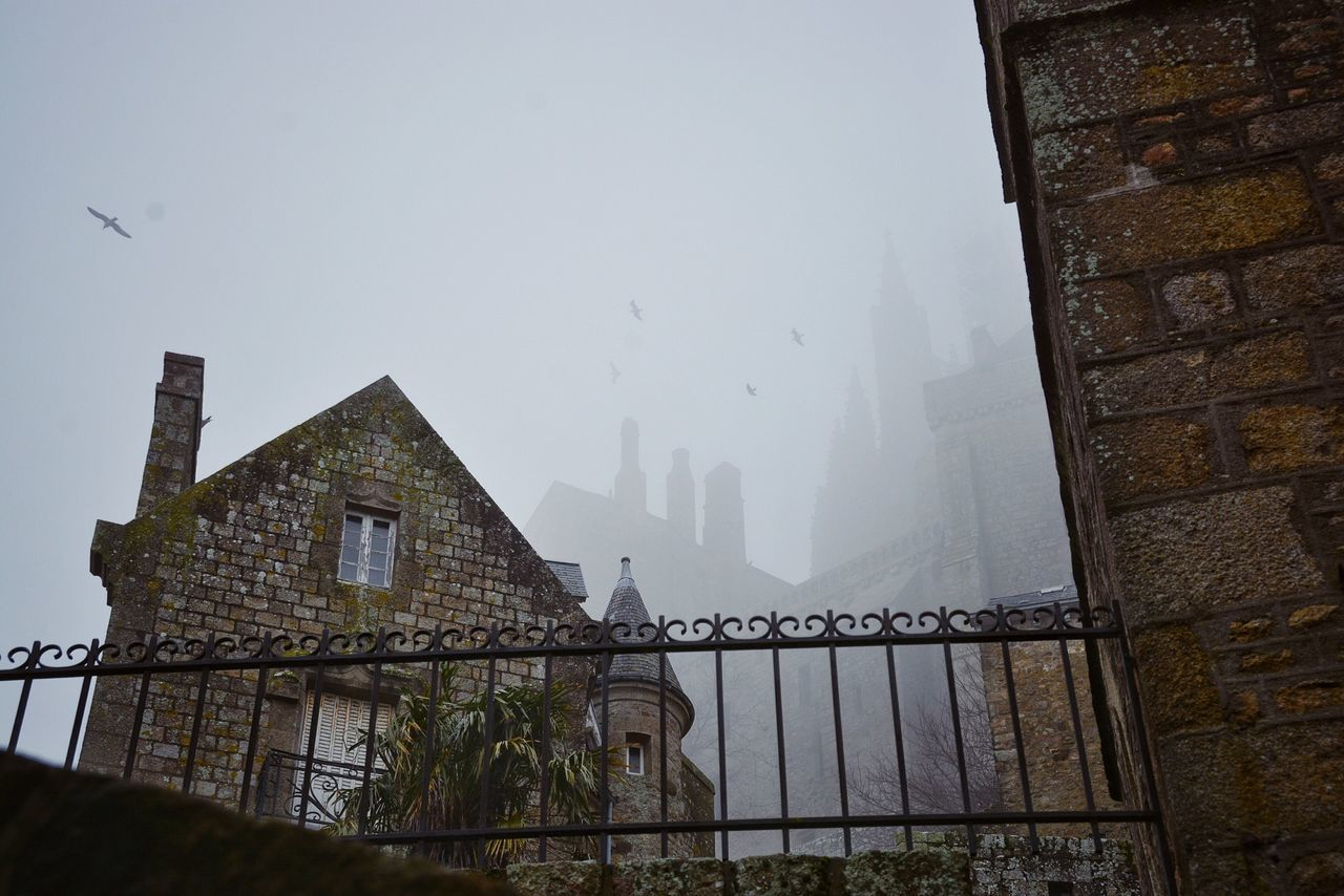 Spooky and Magical. Houses French House French Architecture Mist Fog Dark Day Tenebrous Spooky Atmosphere Historic Site Bretagne Normandy Misty Landscape Haze Cold Weather French Village Old Age Foggy Landscape The Architect - 2016 EyeEm Awards Your Design Story Foggy