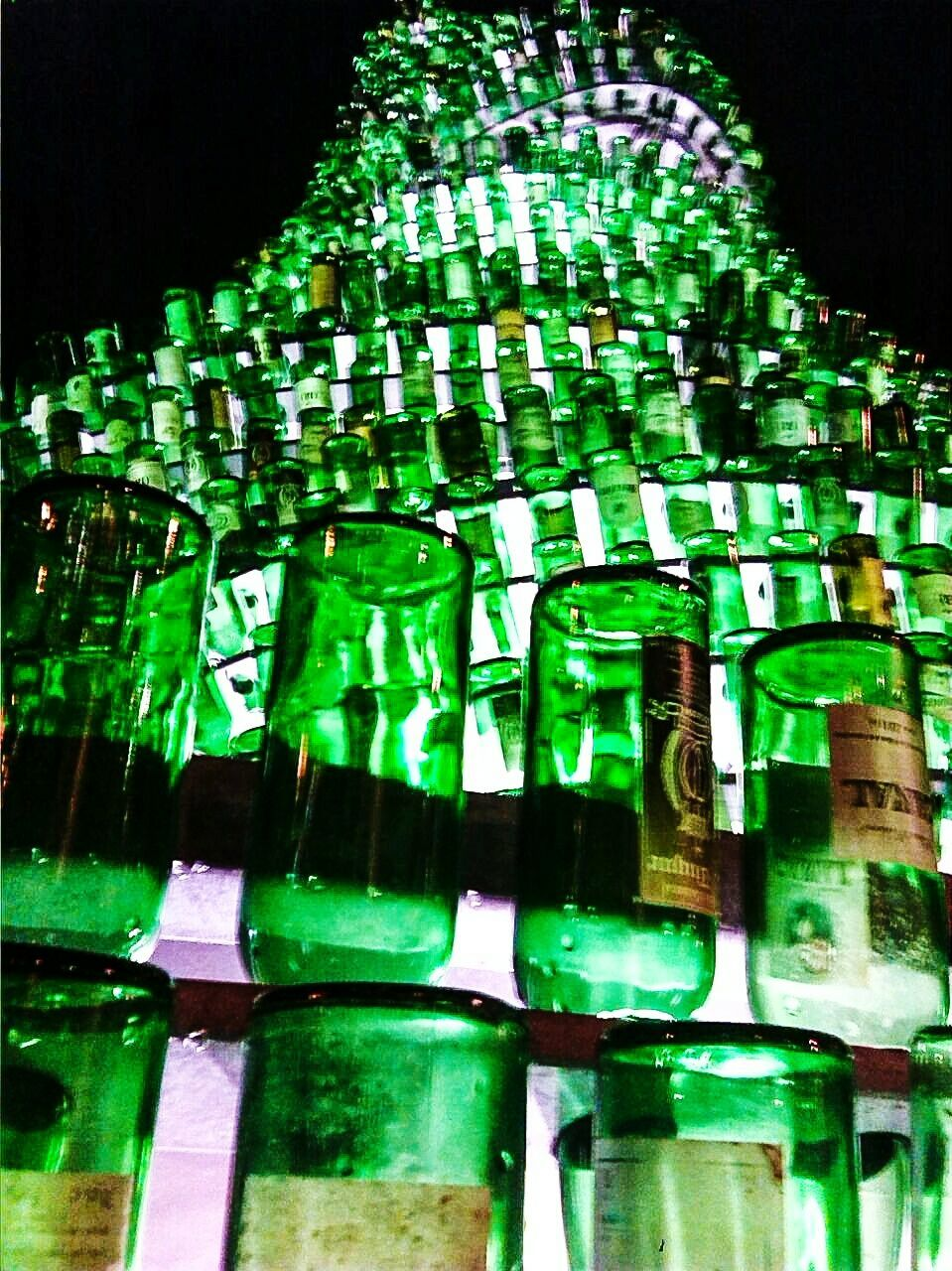 night, no people, illuminated, green color, low angle view, water, outdoors, close-up