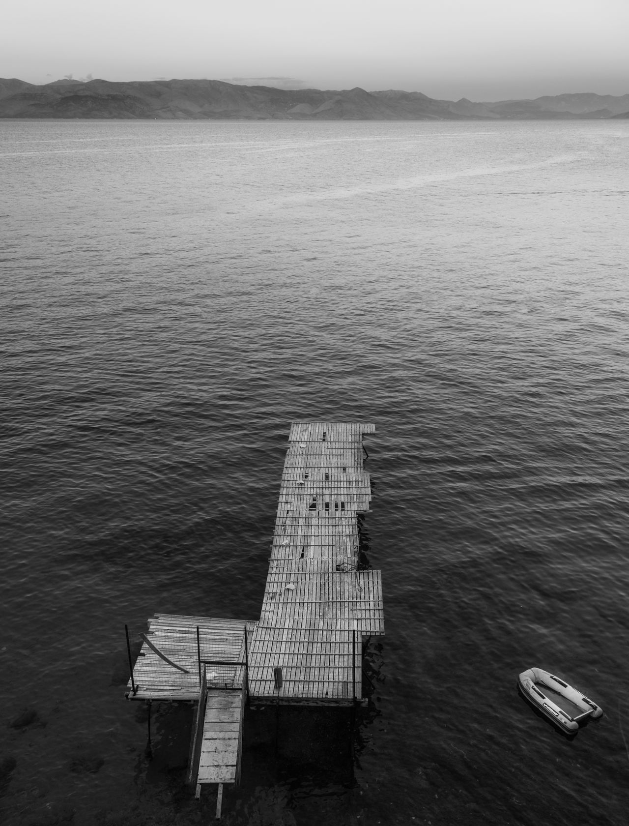 B&w Beauty In Nature Black And White Boat Corfu Town Day Dreamy Dusk Floating Greek Islands Lonely Mediterranean  Nature No People Outdoors Raft Rubber Raft Scenics Sea Sehnsucht Sunset Tranquil Scene Wanderlust Water Wharf