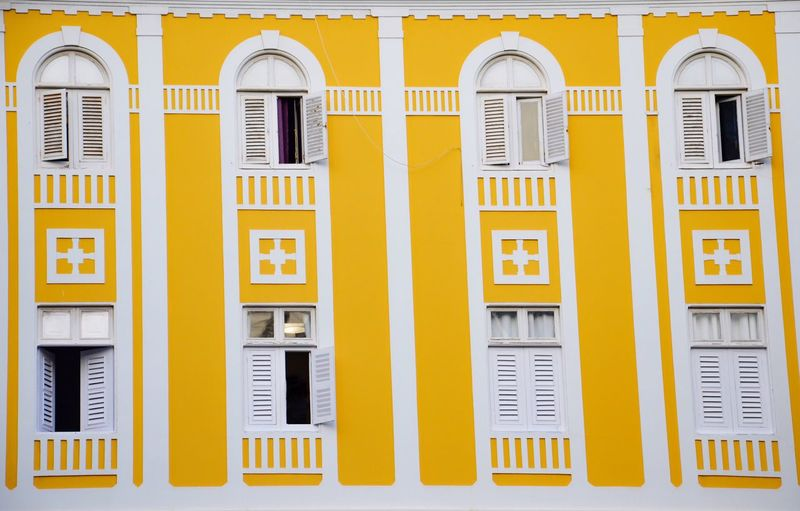 Window Symphony - Reupload Window Building Exterior Yellow Architecture Built Structure Outdoors Full Frame Residential Building No People Day Las Palmas Gran Canaria Window Symphony Security Bar Close-up The Graphic City