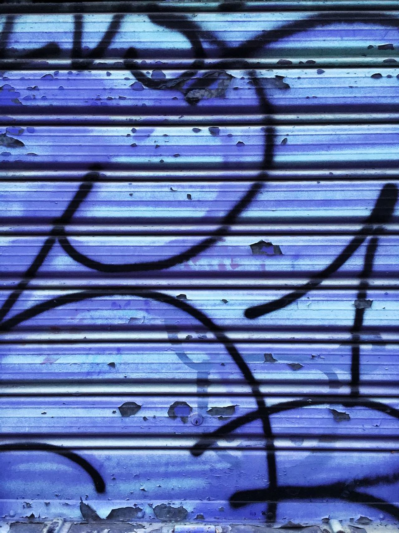 Ruination and paint on a closed gate. Backgrounds Blue Blue Color Closed Drawings Gate Lock Pattern Purple Rusty Shutter Tagged Tags Urban