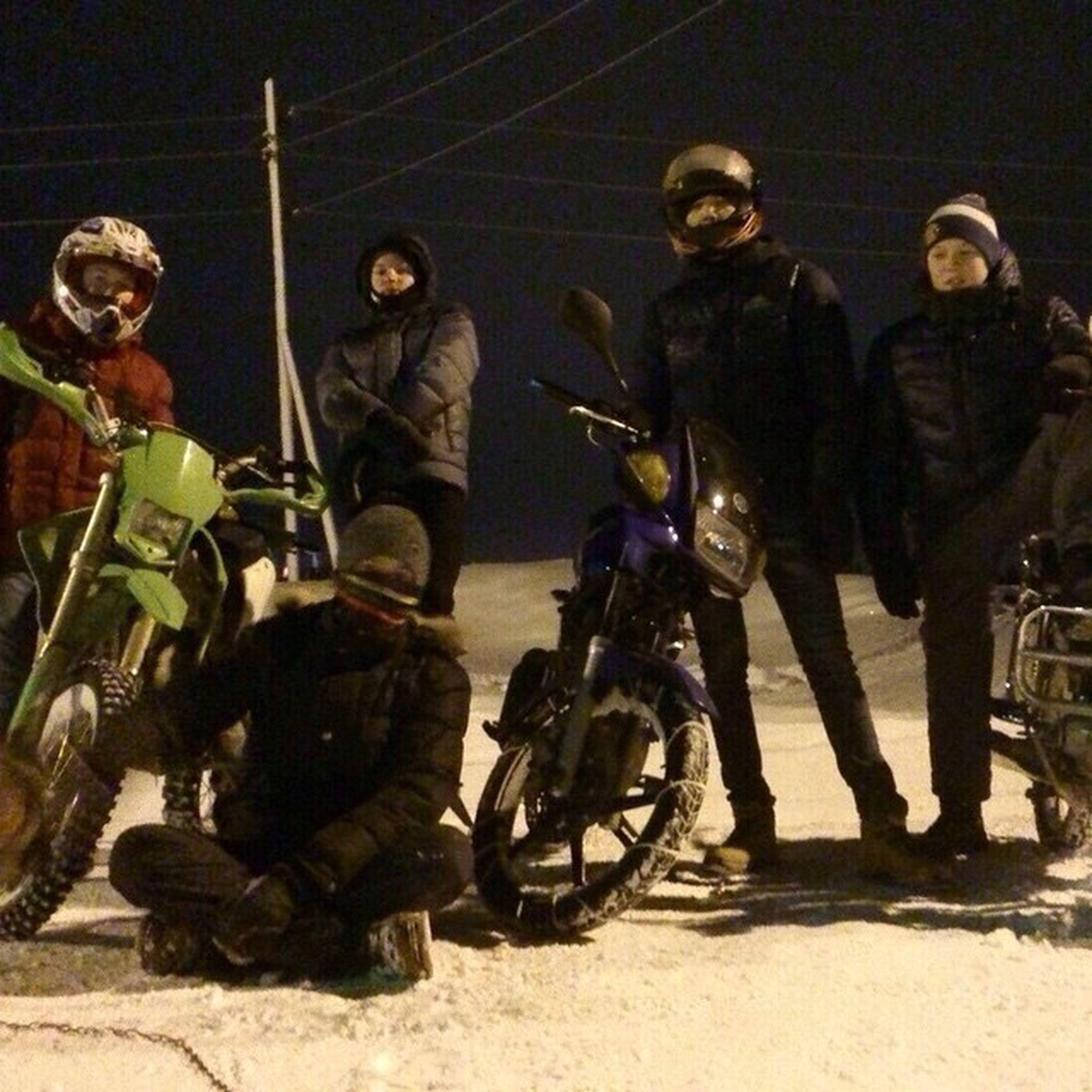 men, lifestyles, leisure activity, full length, bicycle, casual clothing, street, large group of people, transportation, land vehicle, helmet, person, riding, togetherness, mode of transport, motorcycle, outdoors, medium group of people
