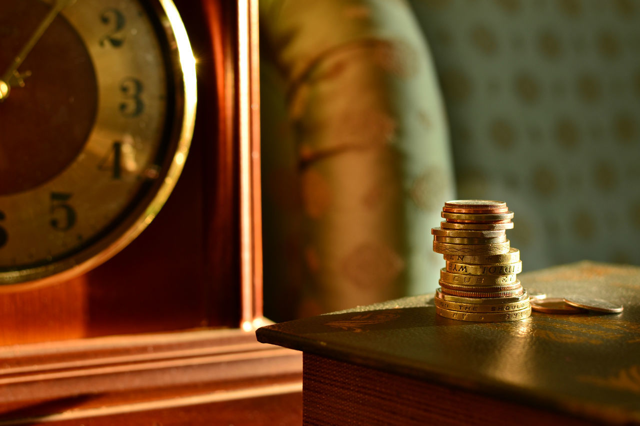 Classic Style Close-up Coins Day Desk Clock Finance Focus On Foreground Gold Colored Illuminated Indoors  Money No People Old-fashioned Old-fashioned Retro Styled Stacked Study Interior Design Sunlit Vintage