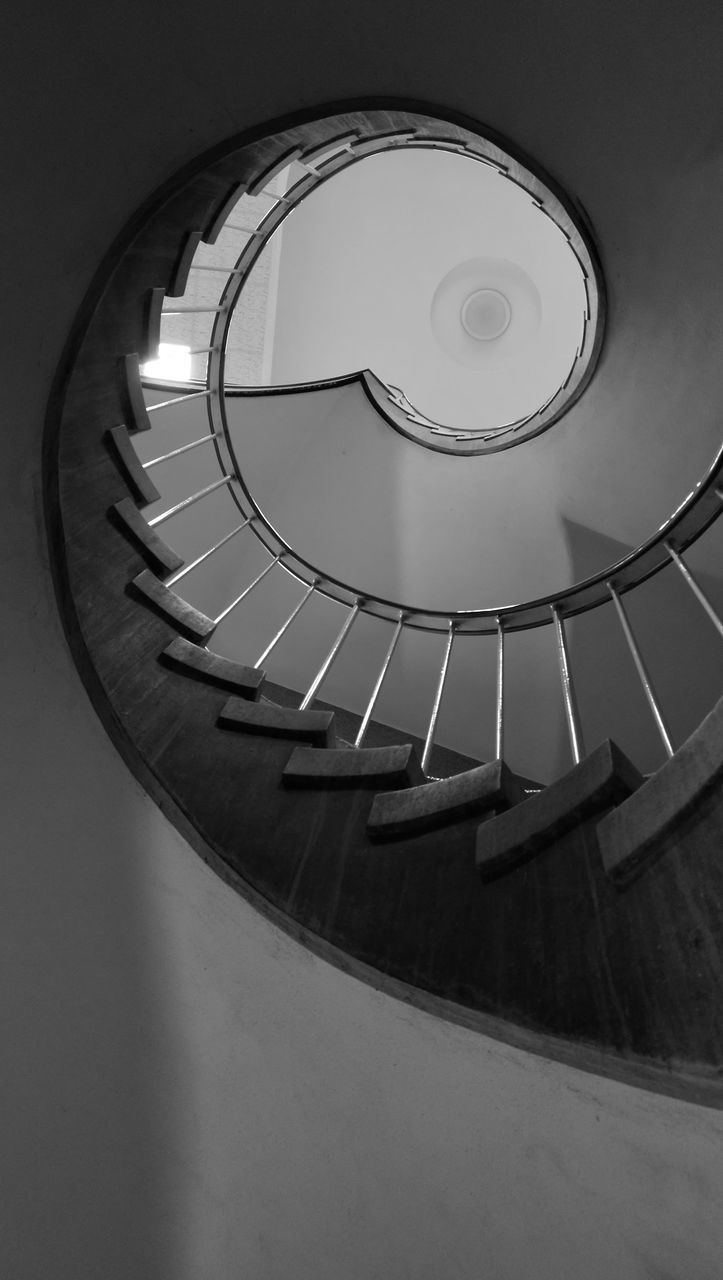 steps and staircases, staircase, architecture, built structure, steps, railing, circle, low angle view, no people, spiral, stairs, spiral stairs, indoors, hand rail, day
