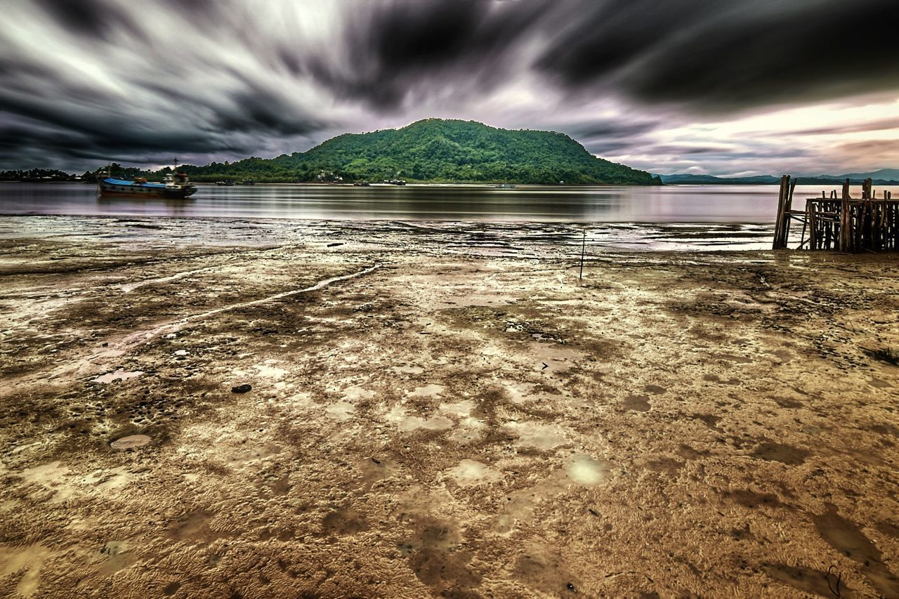 water, nature, scenics, beauty in nature, cloud - sky, sky, sea, outdoors, tranquility, tranquil scene, beach, mountain, no people, day, architecture