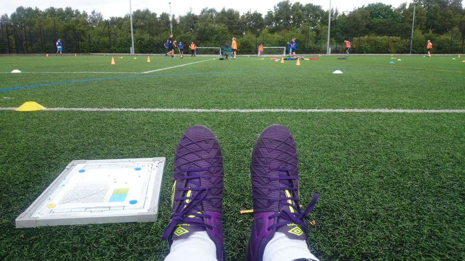 Watching players go through their paces on open day trial Cleats Coach Coaching Day Field Football Grass Grassy Green Green Color Landscape Leisure Activity Lifestyles Outdoors Personal Perspective Relaxation Relaxing Soccer Sport Tactical Tactics Tactics Board Tacticsboard Umbro Unrecognizable Person