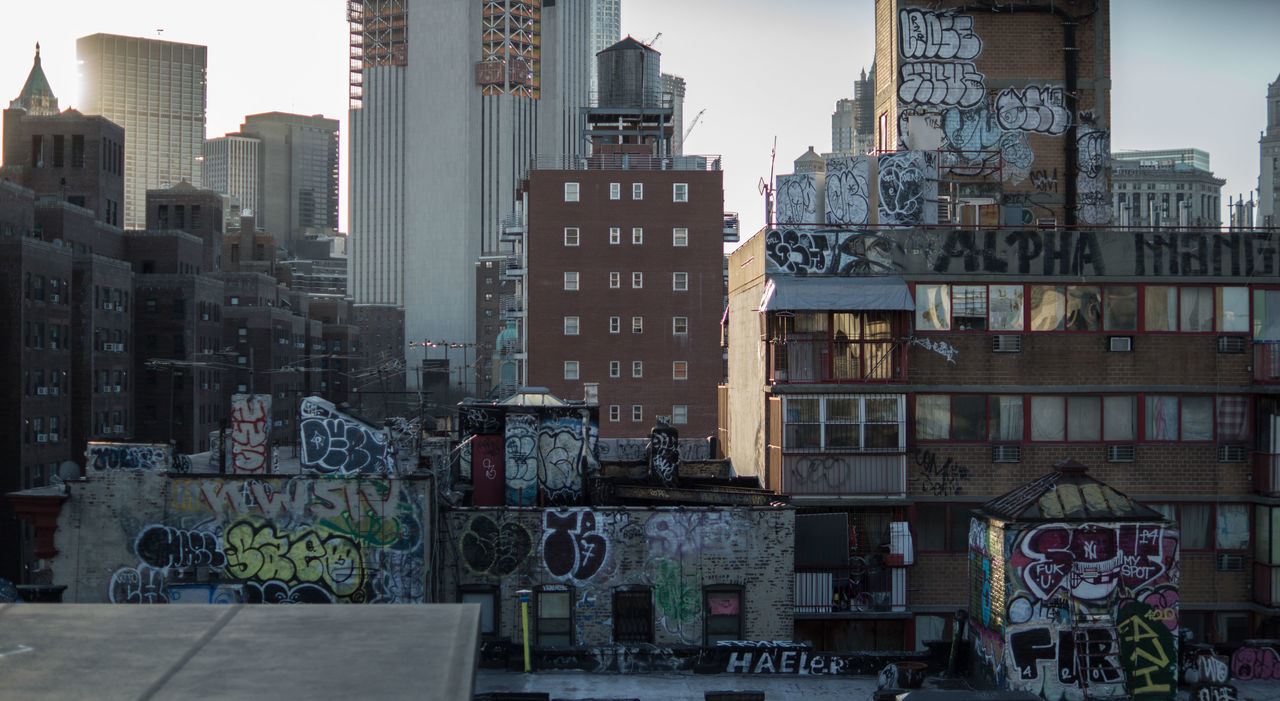 Showcase March How Do We Build The World? Residential District Graffiti Community Cityscapes City Life Building Exterior Urban Sunset New York City Light Streetphotography Residential Structure Human Settlement Architecture Fresh on Market April 2016 The Architect - 2016 EyeEm Awards