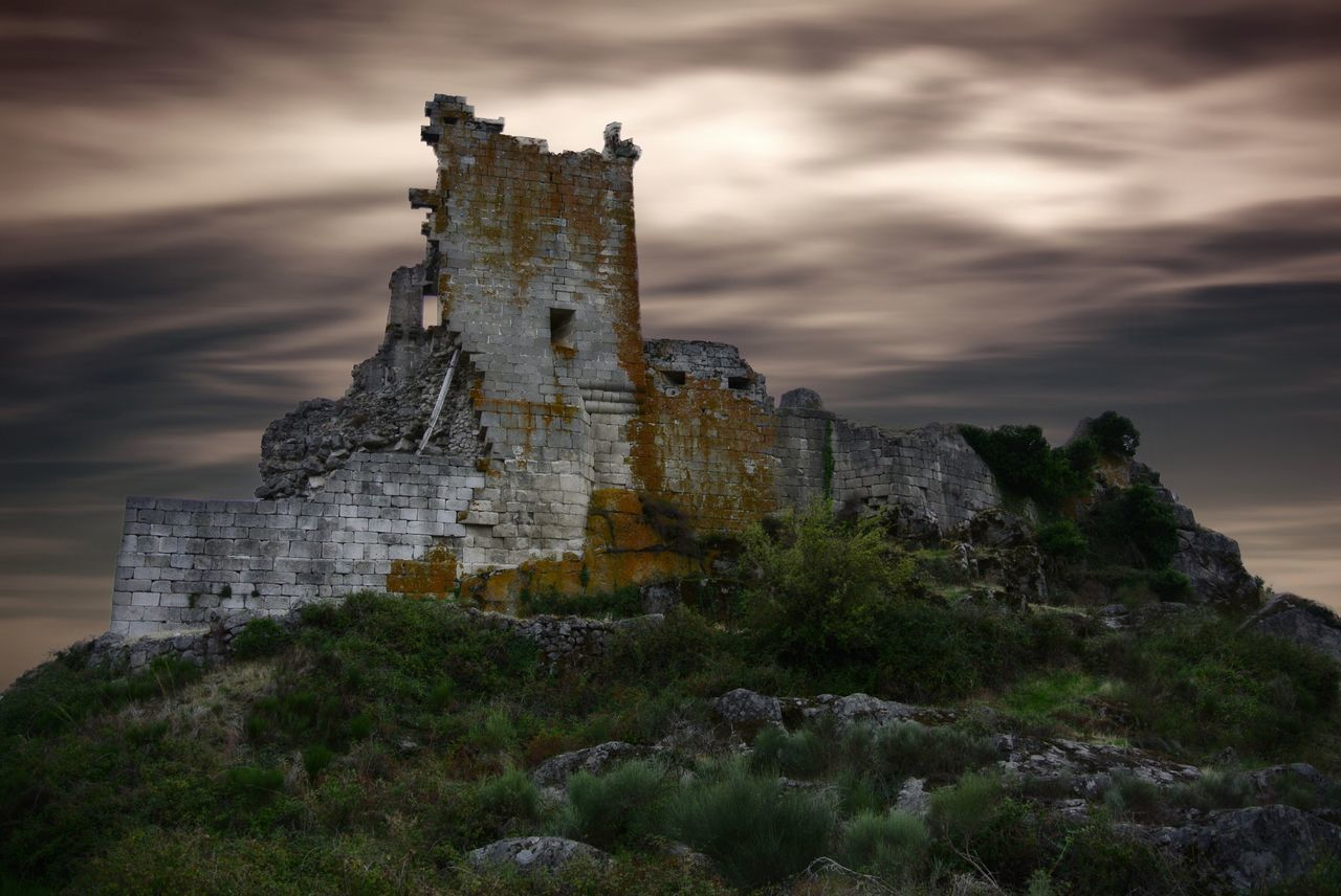 Low Angle View Of Abandoned Castle Against Cloudy Sky